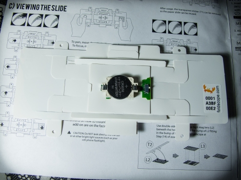 The back of the Foldscope, with LED light and battery attached.
